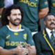 South Africa's Springboks coach Peter de Villiers sits next to team captain John Smit and senior player Victor Matfield.